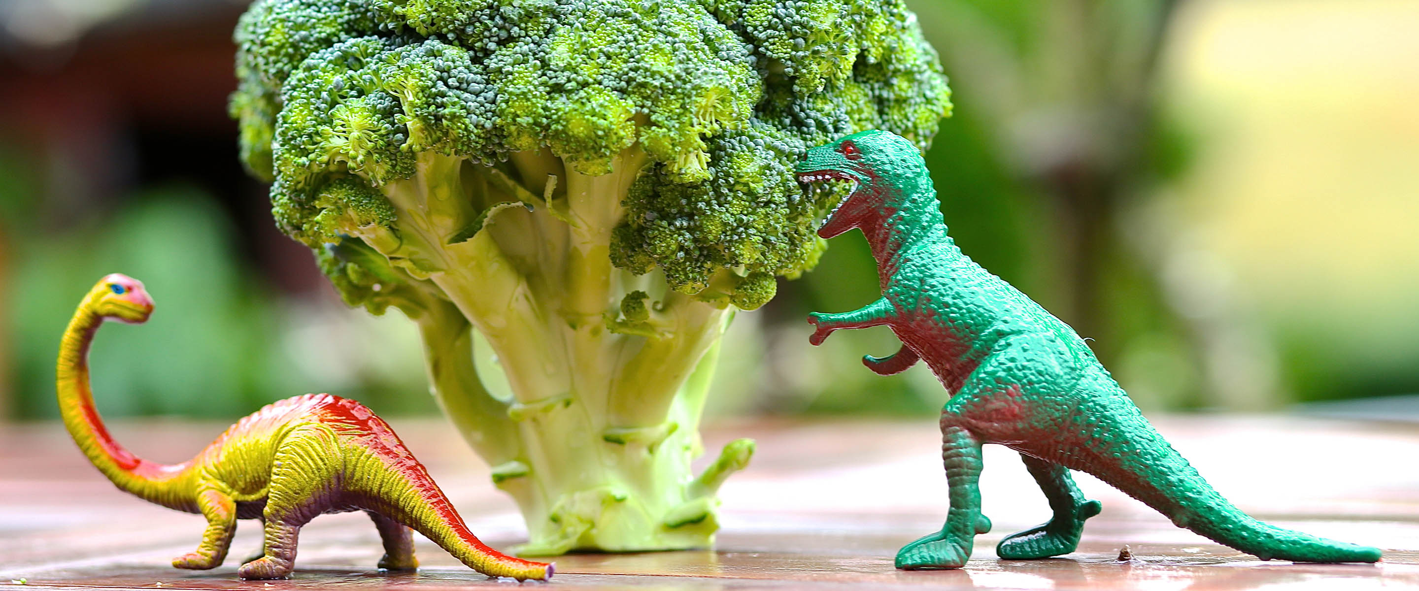Dinosaurs eating brocoli