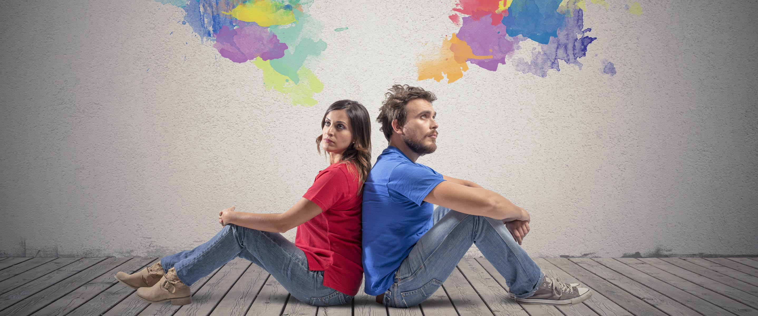 Couple sitting back to back with different ambitions and priorities
