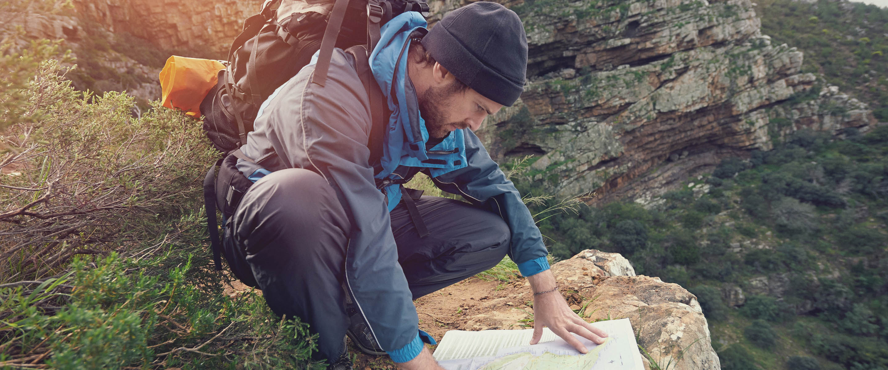 Planning a route using a map while hiking